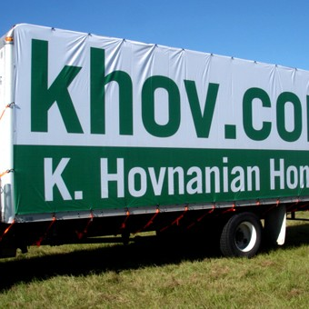 Grand format banner mounted to trailer.