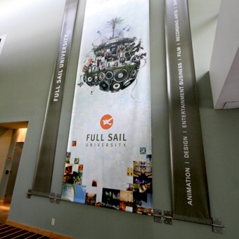 Indoor banner suspended using custom fabricated metal brackets and hardware.